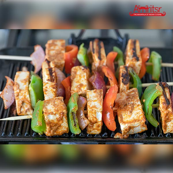 Take out the paneer tikka from the tandoor
